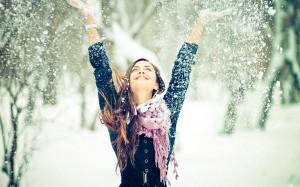 beautiful-girl-throwing-and-enjoying-snow